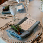 Sprigs of greenery on place settings