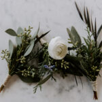 Ranunculus boutonniere with seeded eucalyptus